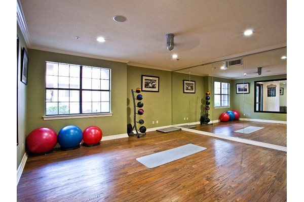 Image of the free space in our fitness center that includes yoga balls and medicine balls