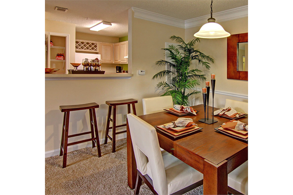 Dining Area and Breakfast Bar at Brentwood Downs Apartment Homes in Lilburn, Georgia, GA