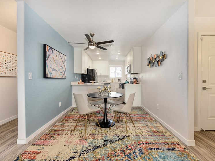 Dining Area with Hallway, Table, Rugs and Ceiling Fan/Light