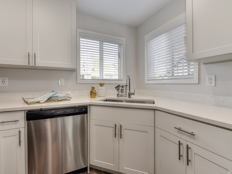 Kitchen Sink with Window, White Cabinets and Dishwasher