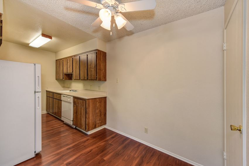 Dining Room with Hardwood Inspired Floor, Refrigerator, Ceiling Fan/Light and Wood Cabinets