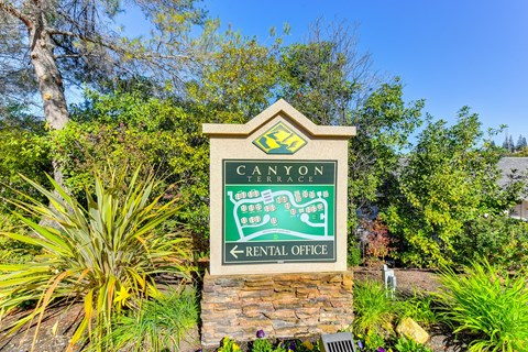 Outdoor Canyon Terrace Rental Office Sign with Stone Foundation, Plants