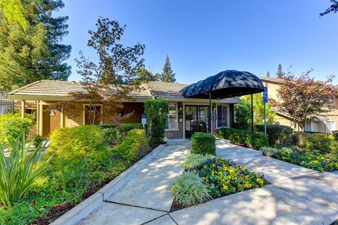 Rental Office Exterior with Flower Beds, Walking Path, Trees