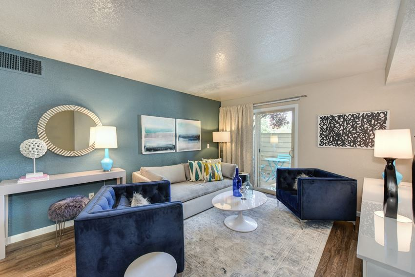 Living Room with Window,  Hardwood Inspired Floors, White Carpet, Blue Suede Chair, White Sofa, Lamps