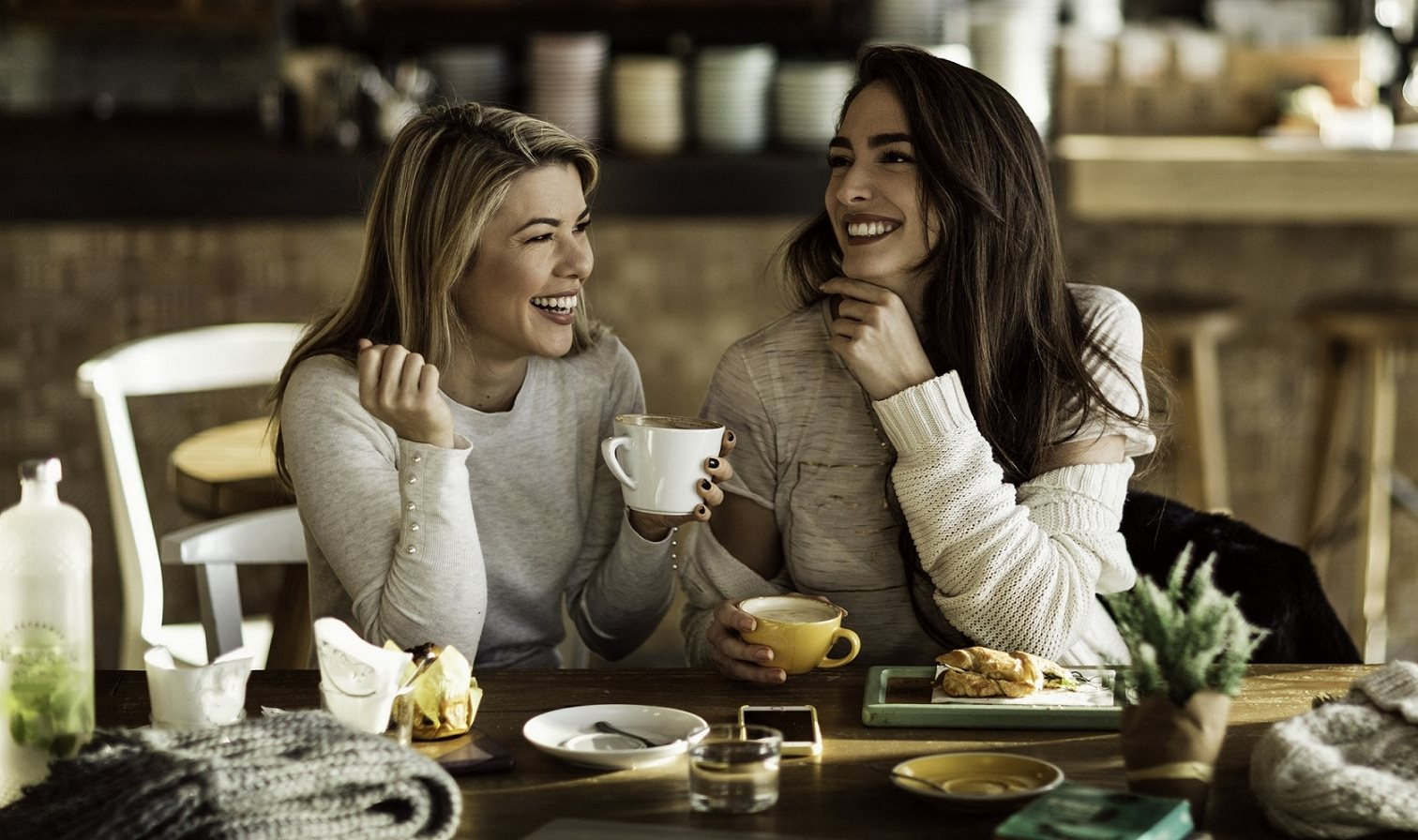 Coffee Shop with Two Smiling Women