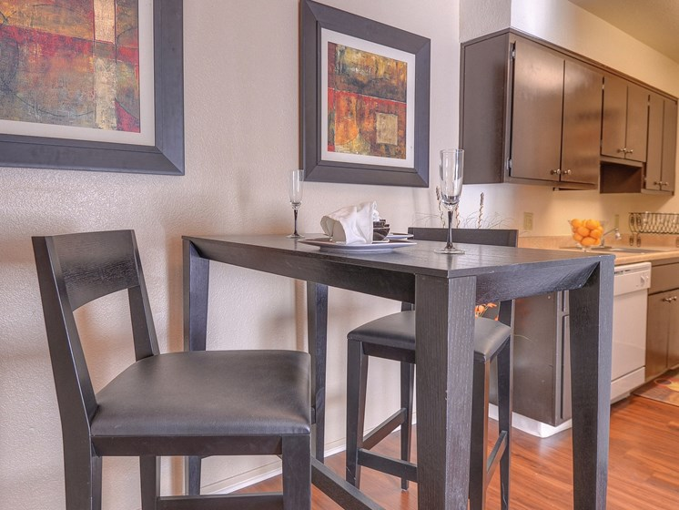 Affordable Apartment Dining Area Kitchen Hardwood Floor Wood Inspired Floors Refrigerator Dishwasher