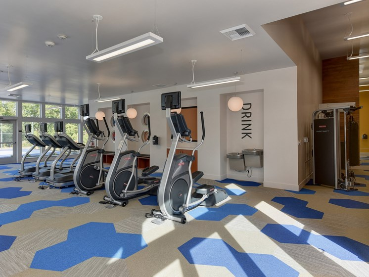 Community Fitness Center Ellipticals, Water Fountains, and Ceiling Lights