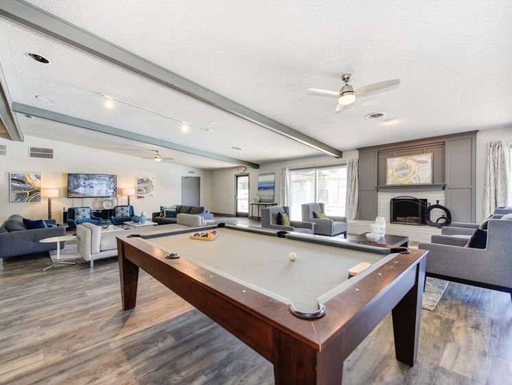 Clubhouse Sitting Area with Pool Table, Hardwood Inspired Floor, Gray and White Sofas