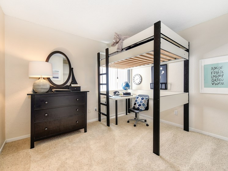 Bedroom with Bunk Bed, Carpet, White Desk, Black Dresser and Window