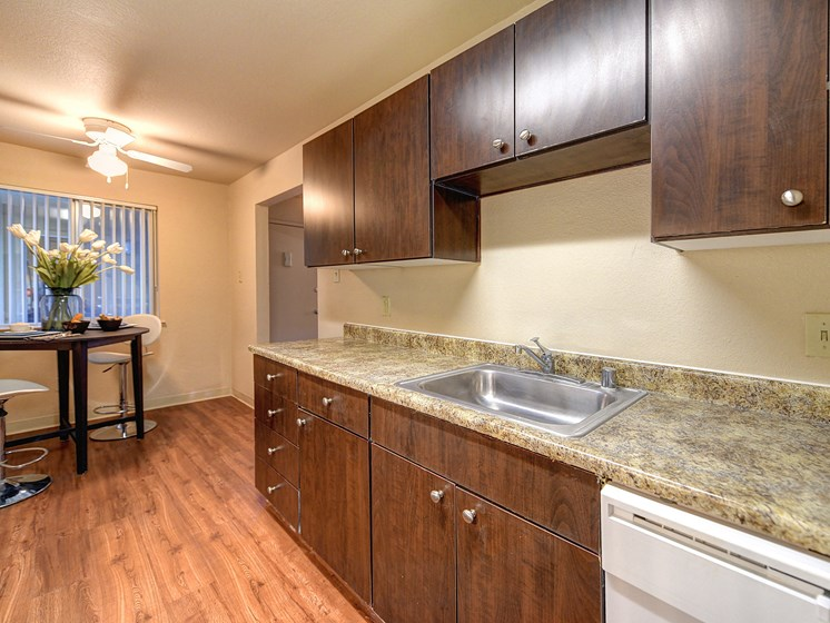 Luxury Apartment Kitchen with Granite Quartz Countertops Hardwood Inspired Floors and Dining Area