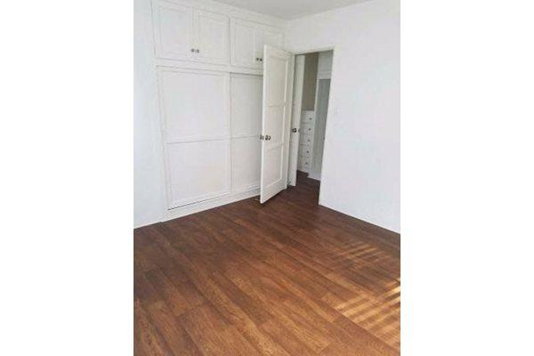 Bedroom with Wood Vinyl Flooring