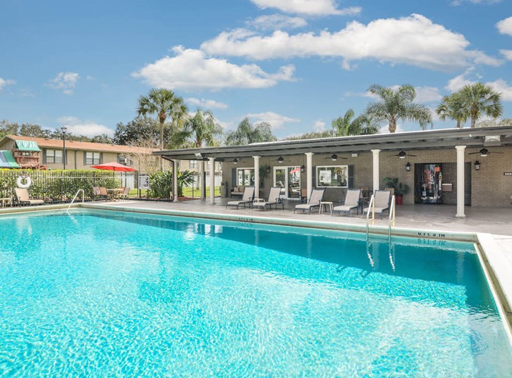 Veridian Townhomes apartments Melbourne, FL 32935 pool and sun deck with lounge chairs