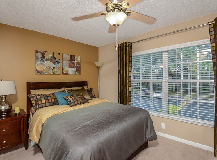 Veridian Townhomes apartments Melbourne, FL 32935 large bedroom with ceiling fan and large windows