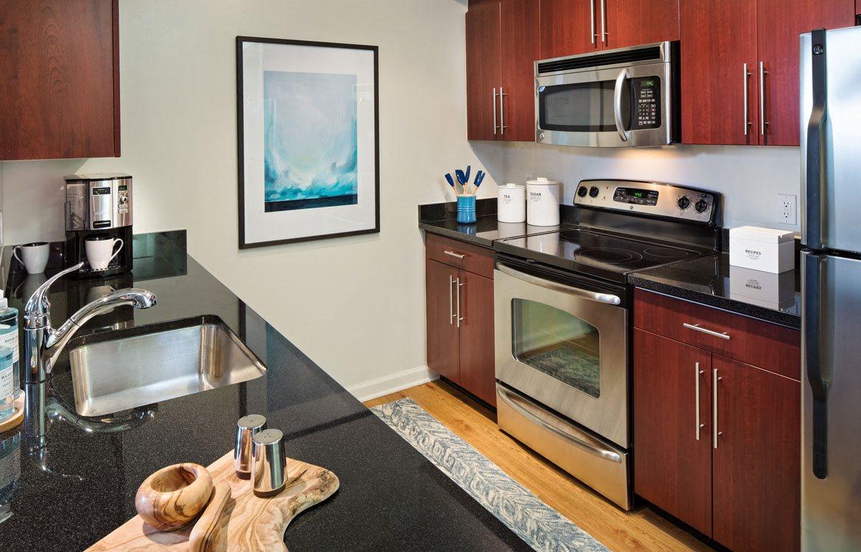 Stainless steel appliances - Model Kitchen, Apartments in Washington, D.C