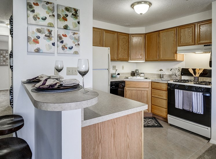 Kitchen and Breakfast Bar at Ashmore Trace Apartments
