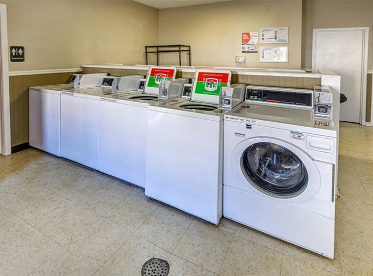 Laundry Center with coin and app-based operated machines.