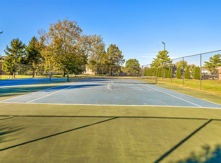 Fenced-in Tennis Court at Briarwood Columbus