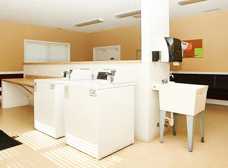 Coin-loaded washers and dryers available in the Resident Laundry Center