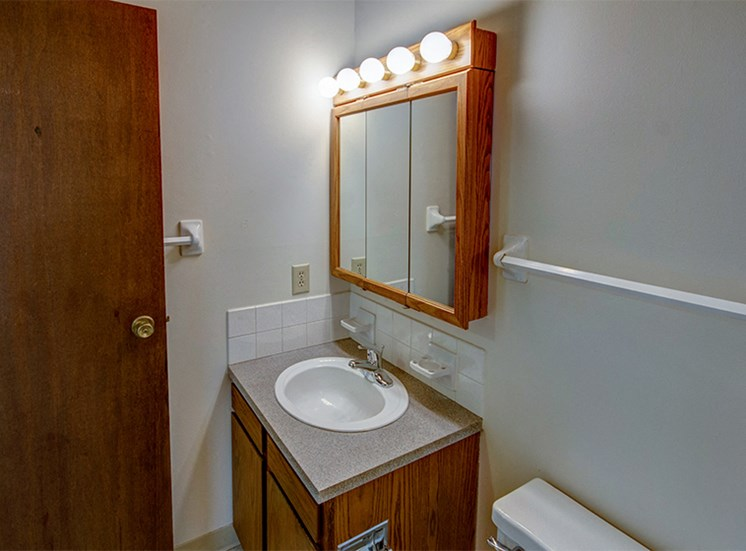 One bedroom bathroom with vanity and medicine cabinet.