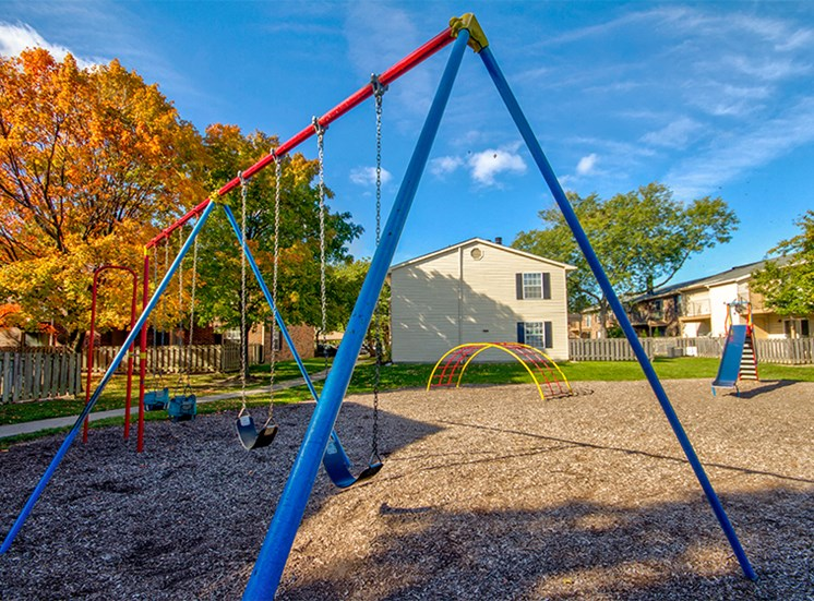 Playground with swings, slides, and climbing obstacles.