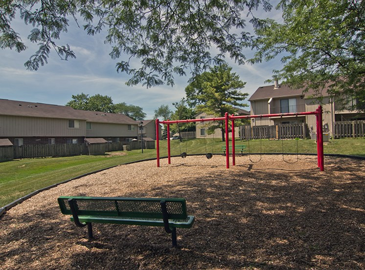 Playground with swings at Brookview Apartments