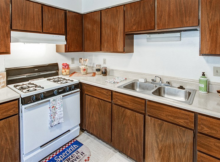 Kitchen with white appliances and plenty of cabinetry for food and kitchen utensil storage