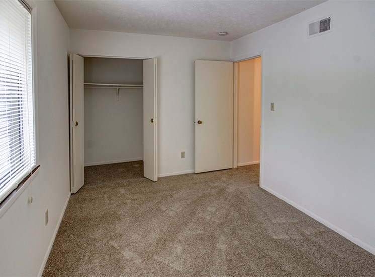 Guest Bedroom with Closet at Woodlake Apartments