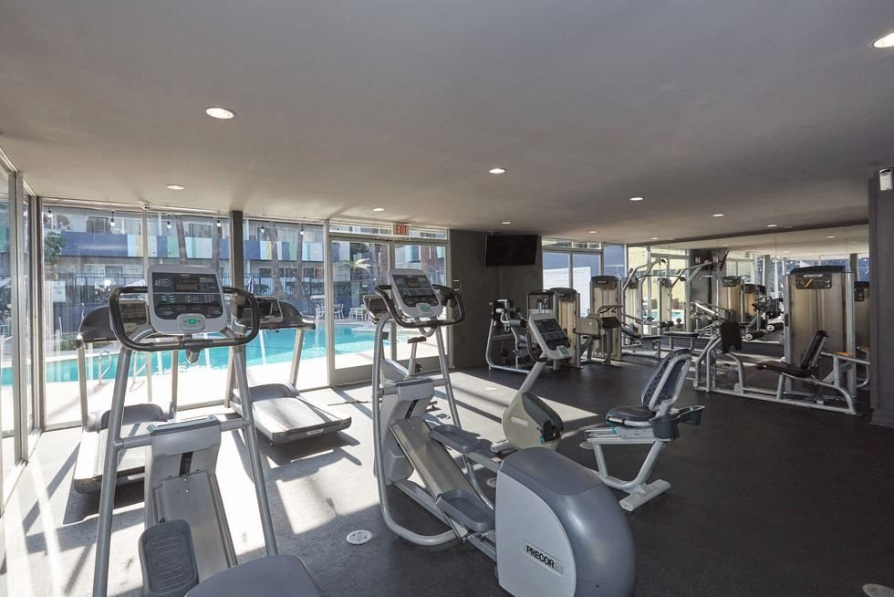 Torrance, CA Apartments for Rent - Milano Fitness Center with Exercise Bike, Treadmills, and Ellipticals