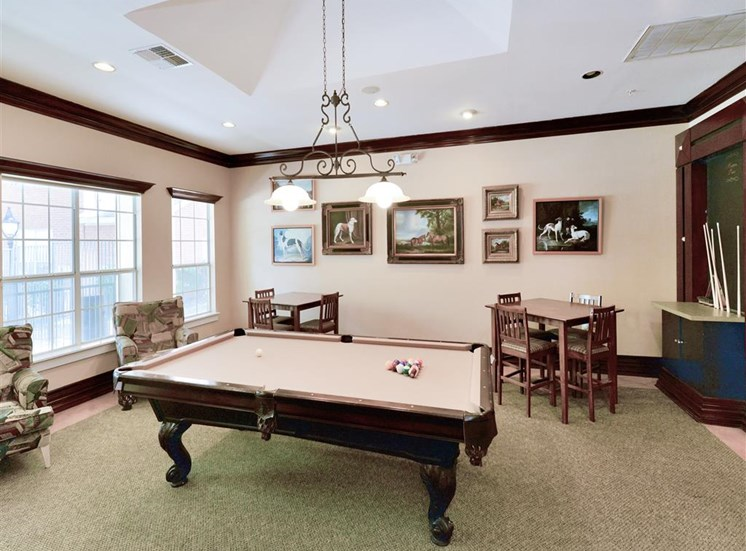 Card tables and pool table in social center at Montfort Place in North Dallas, TX, For Rent. Now leasing 1 and 2 bedroom apartments.