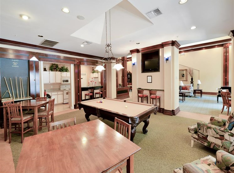 Handsome wooden molding and Pool Table of Montfort Place in North Dallas, TX, For Rent. Now leasing 1 and 2 bedroom apartments.