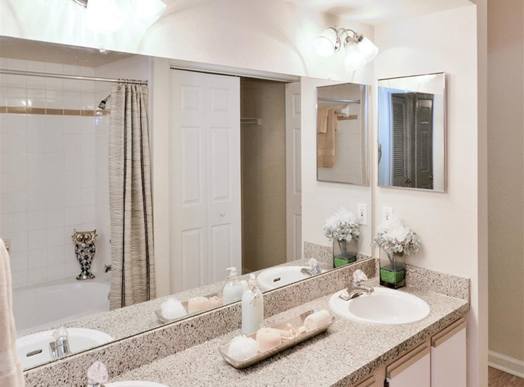 Double bathroom vanity at Montfort Place in North Dallas, TX, For Rent. Now leasing 1 and 2 bedroom apartments.