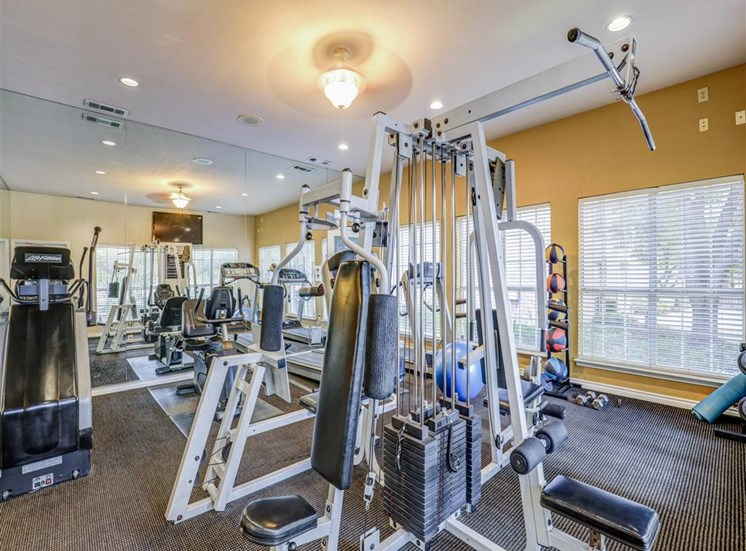 Fitness center Gym at Trinity Square Apartments in North Dallas, TX, For Rent. Now leasing 1 and 2 bedroom apartments.