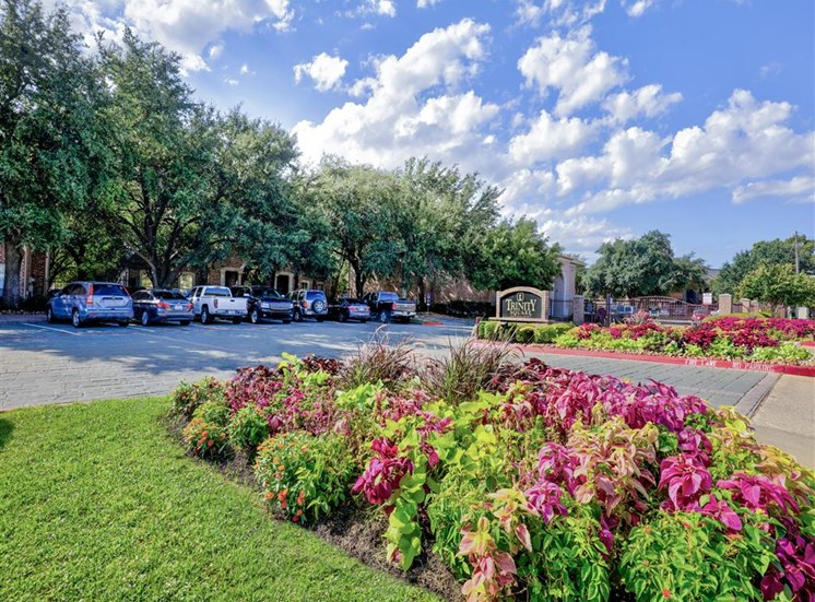 Gated entry to Trinity Square Apartments in North Dallas, TX, For Rent. Now leasing 1 and 2 bedroom apartments.