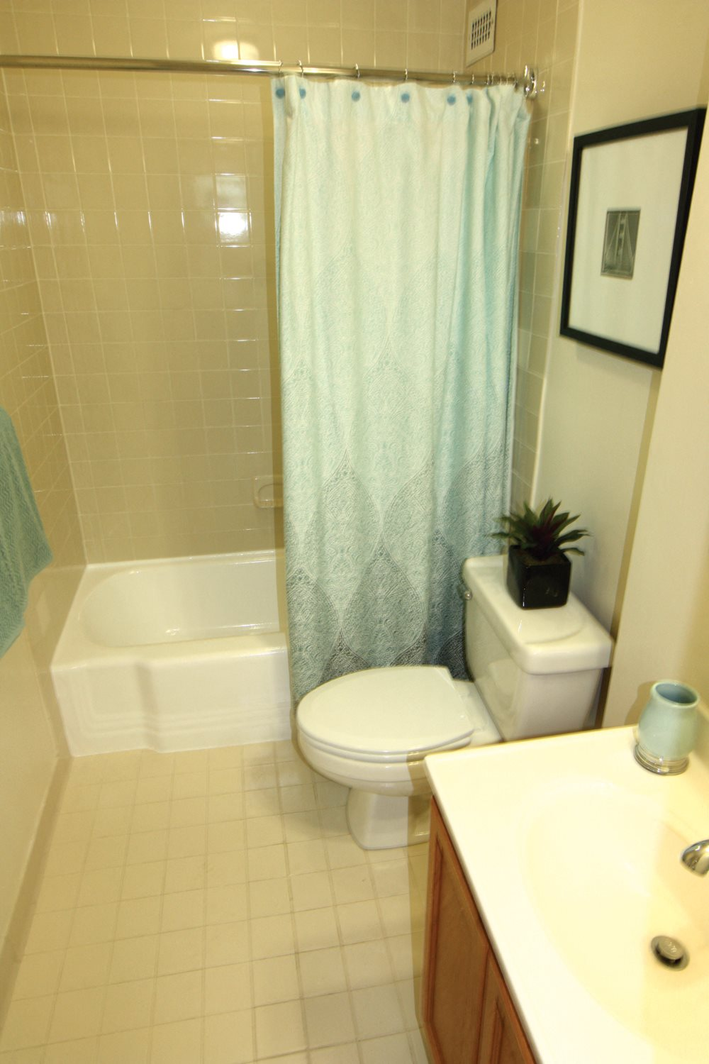Spacious Bathrooms With Ceramic Tile Flooring at Calvert House