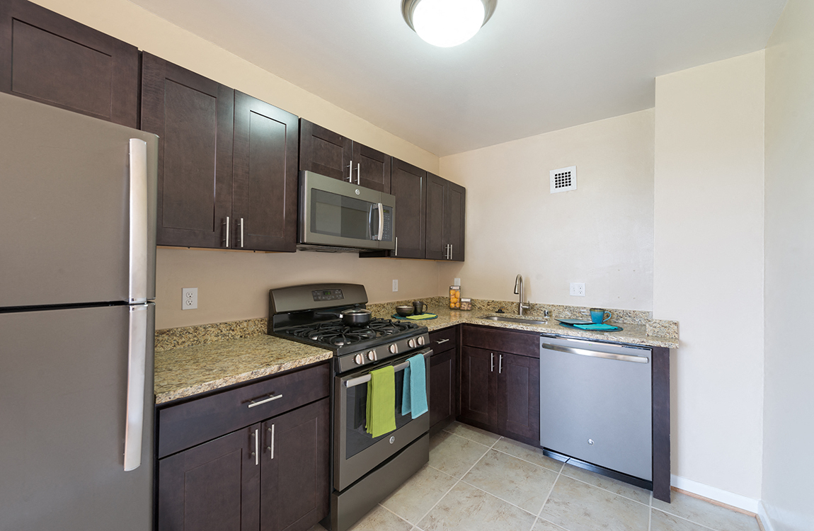 GE Slate Appliances With 5 Burner Gas Stove At Connecticut Park Apartments,  Washington,
