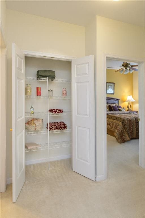 Clean-Lined Silhouette, Crisp White Finish, Spacious Open Shelving Linen Closet