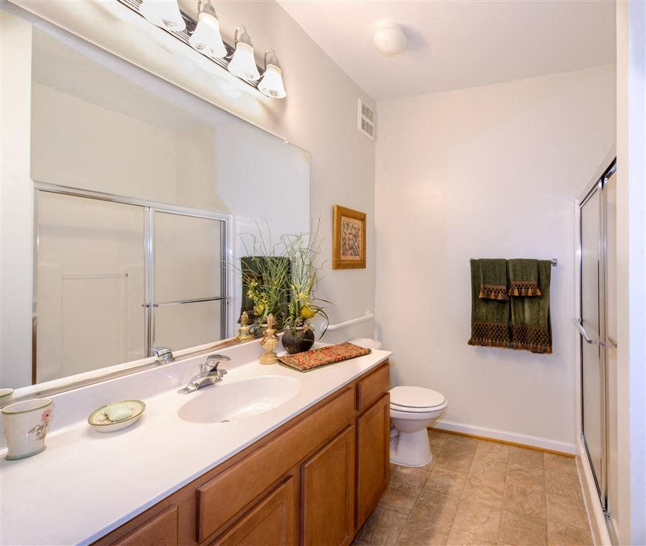 Guest Full Bathroom With Sliding Shower Doors For Easy Access