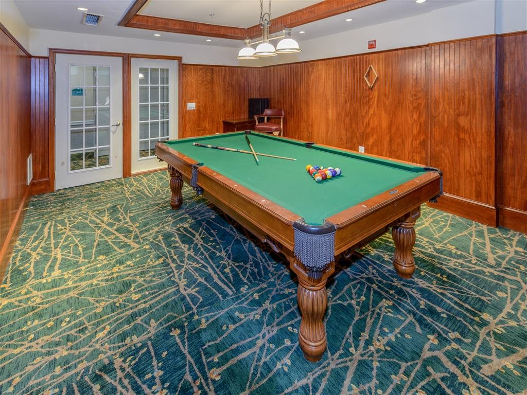 The Billiard Room Lounge offers A Billiard Table for Your Afternoon Or Evening Entertainment