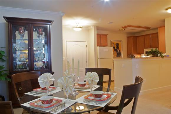 Kitchen with dining table at The Marque at Heritage Hunt, Gainesville, VA,20155