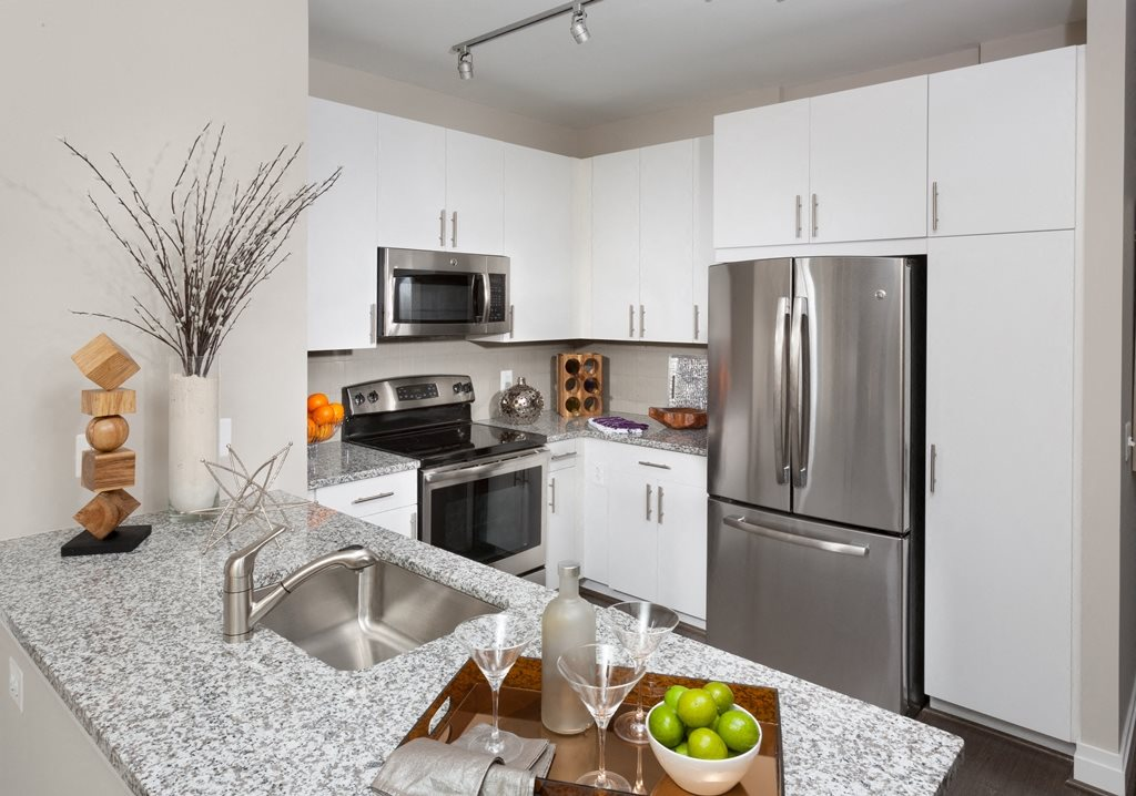 All Electric Kitchen with White Cabinets at Harrison at Reston Town Center, Reston, VA, 20190