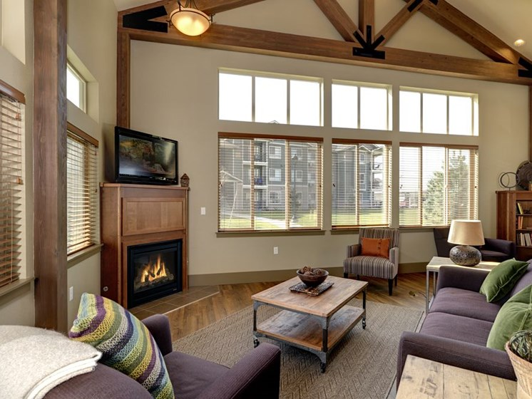 Clubhouse with seating and fireplace Apartments in Colorado Springs, Co  Copper Creek Apartments
