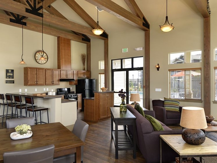Clubhouse with seating and kitchen Apartments in Colorado Springs, Co  Copper Creek Apartments