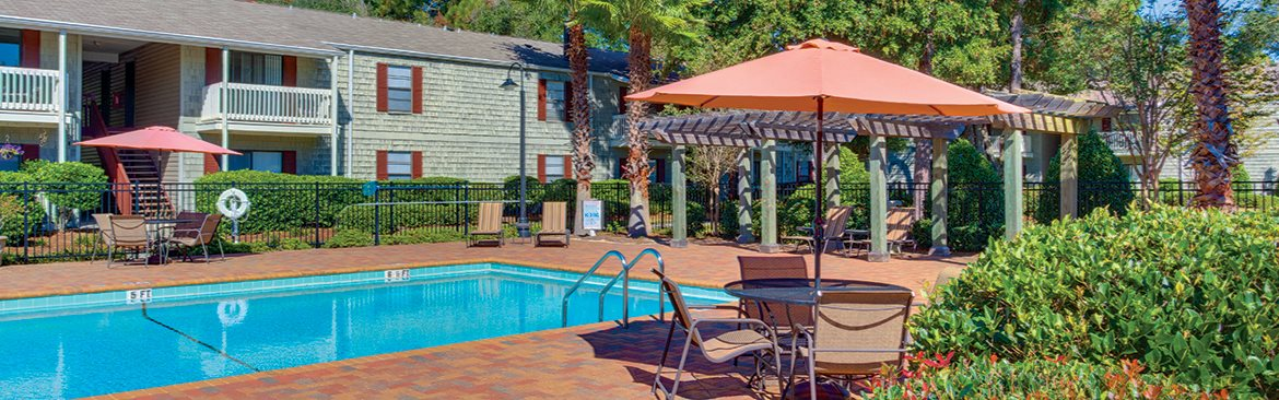 Apartments in Pensacola with a sparkling pool, poolside seating and Wi-Fi
