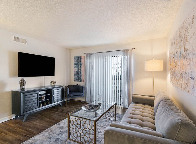 Woodcliff model suite living area in Pensacola, Florida