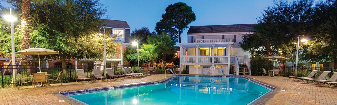 Apartments in Pensacola with a sparkling pool and several poolside lounge areas