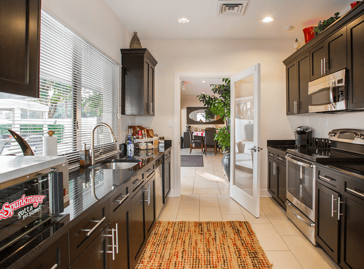 Village Crossing apartments resident community kitchen in West Palm Beach, Florida