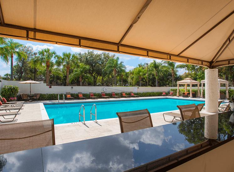 Village Crossing apartments poolside tiki bar in West Palm Beach, Florida