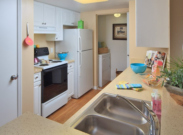 Woodbine apartment model suite kitchen in Riviera Beach, Florida