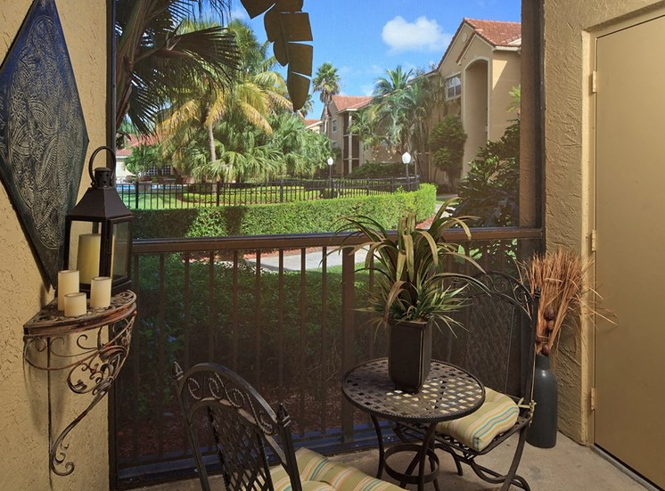 Woodbine apartment model suite screened porch in Riviera Beach, Florida