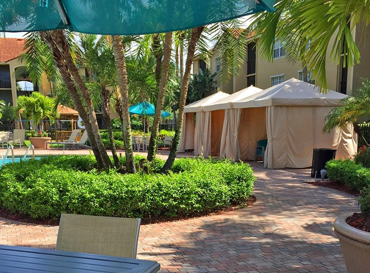 Woodbine apartments poolside cabanas in Riviera Beach, Florida